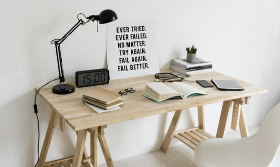 Desk set up with motivational poster on trying again