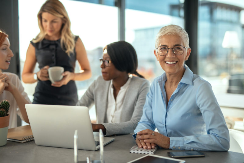 Diverse female employees working together